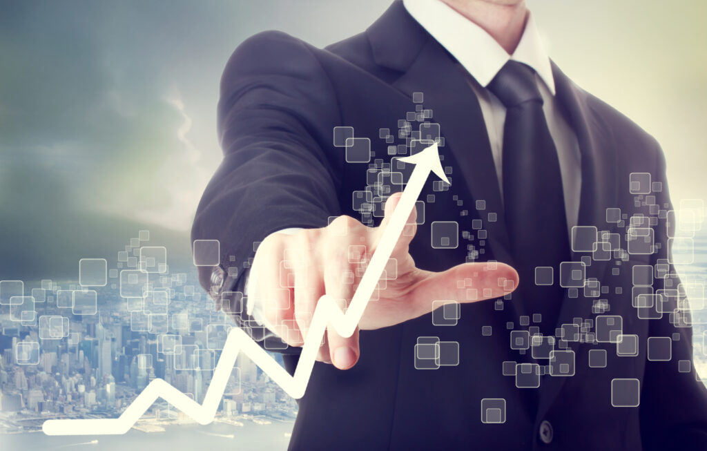 business man touching graph indicating growth