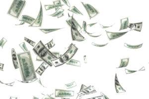 3d money falling on white background
